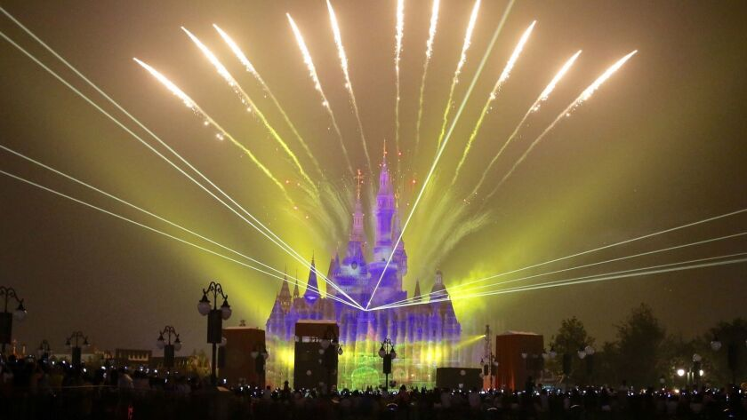Fireworks are set off over the Shanghai Disney Resort on its opening day, June 16.