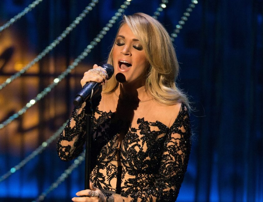 FILE - In this Dec. 2, 2015 file photo, country singer Carrie Underwood performs during the Sinatra 100 - An All-Star Grammy concert at The Wynn Las Vegas. Underwood, Kenny Chesney, Keith Urban, Florida Georgia Line and Cam are the first performers announced Thursday, Feb. 25, 2016, for the 51st annual Academy of Country Music Awards. The show will be broadcast live from the MGM Grand Garden Arena in Las Vegas on April 3 on CBS. (Photo by Eric Jamison/Invision/AP)