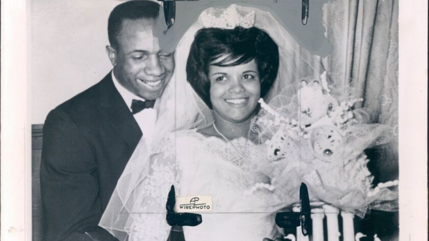 Frank Robinson and his bride, Barbara Ann Cole, on their wedding day in 1961. Wire services reported that they planned to honeymoon in Nevada.