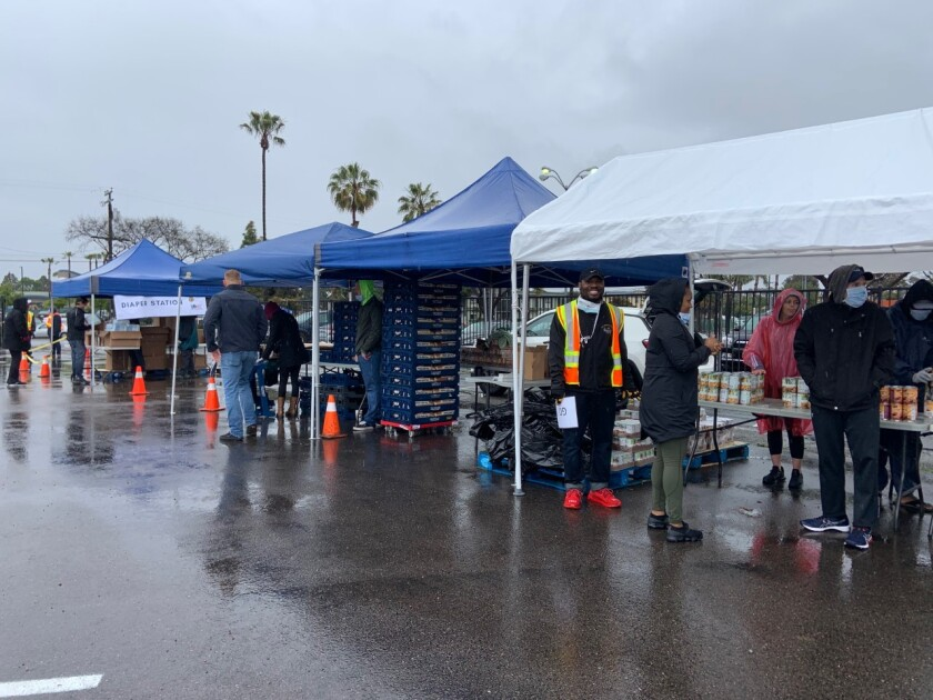 Volunteers from the Veterans Association of North County and American Legion Post 760 in Oceanside distributed food, in a drive-thru, to active duty military and veterans during the coronavirus pandemic.