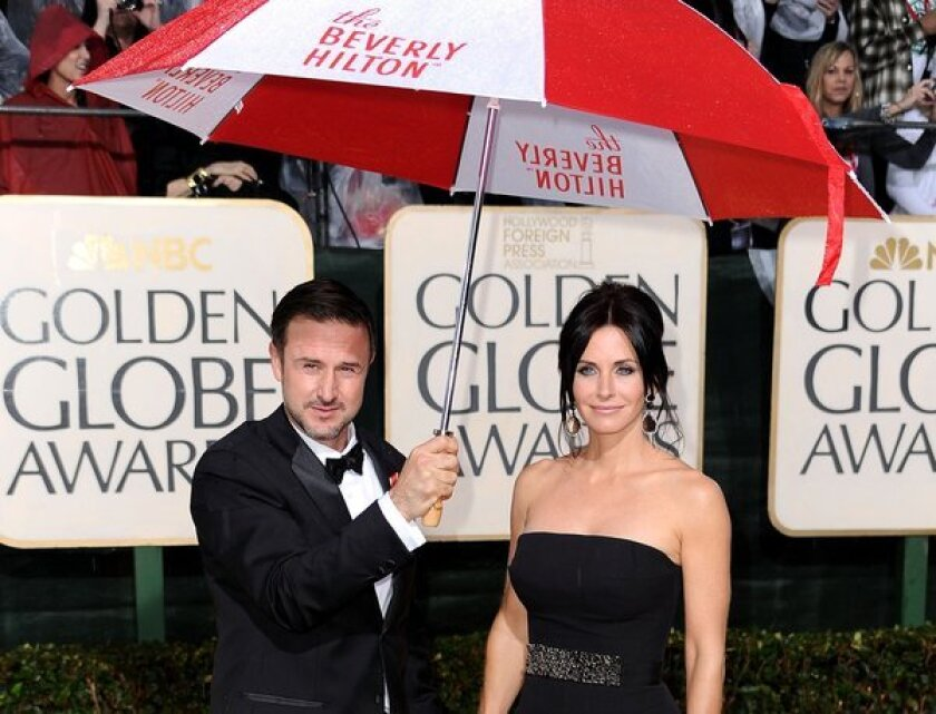 David Arquette and Courteney Cox, who finalized their divorce, arrive at the Golden Globe Awards together in 2010.