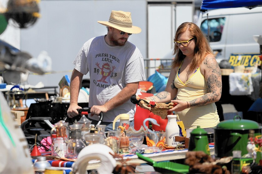 Shoppers peruse offerings at the Orange County Market Place at the fairgrounds in Costa Mesa.
