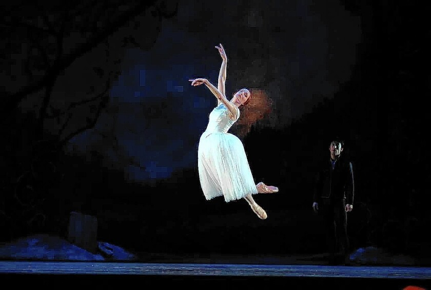 """Gillian Murphy appears as Giselle in Royal New Zealand's 2013 production of the romantic ballet """"Giselle."""" Qi Huan, back, portrays Albrecht, Giselle's love interest who betrays her trust."""