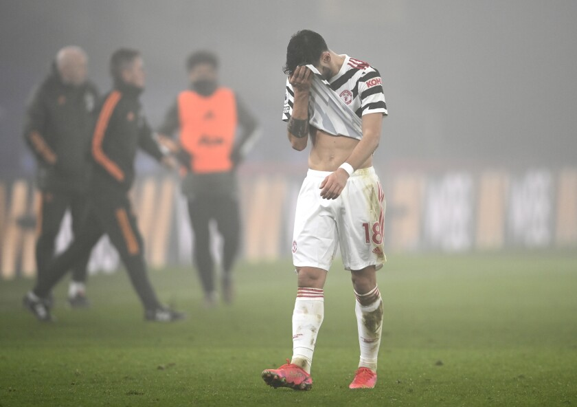 Manchester United's Bruno Fernandes reacts after the English Premier League soccer match between Crystal Palace and Manchester United at Selhurst Park stadium in London, England, Wednesday, March 3, 2021. (Mike Hewitt/Pool via AP)