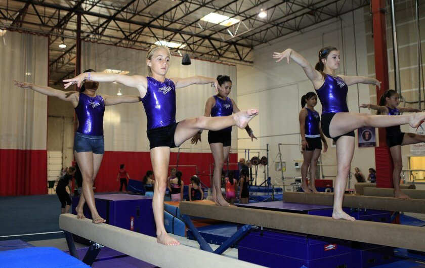 South Bay YMCA gymnasts practicing on the beam in preparation for the national gymnastics competition held in Ohio on June 22.