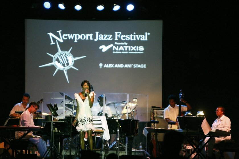 FILE - In this Aug. 2, 2013 file photo, Natalie Cole performs at the opening night of the Newport Jazz Festival in Newport, R.I. The festival will expand to three full days of performances in 2014 to celebrate it's 60th anniversary. (AP Photo/Joe Giblin, File)