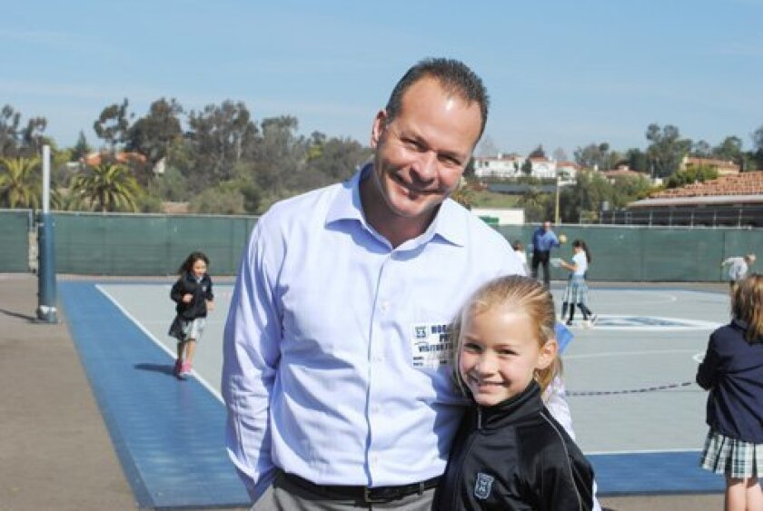 Horizon Prep 2nd grader Paige Gonor with her dad, Richard.