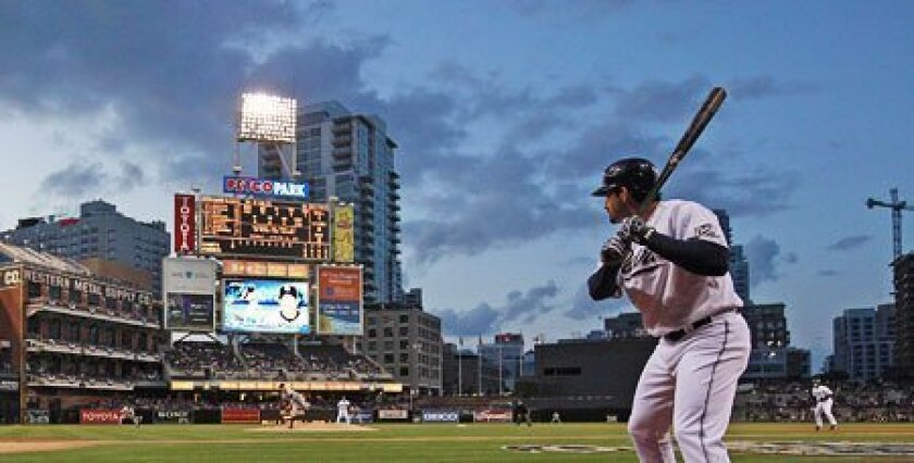 With storm clouds brewing early in the season, the Padres need to make some changes, like moving Kevin Kouzmanoff and signing Adrian Gonzalez to a long-term deal. (John McCutchen / Union-Tribune)