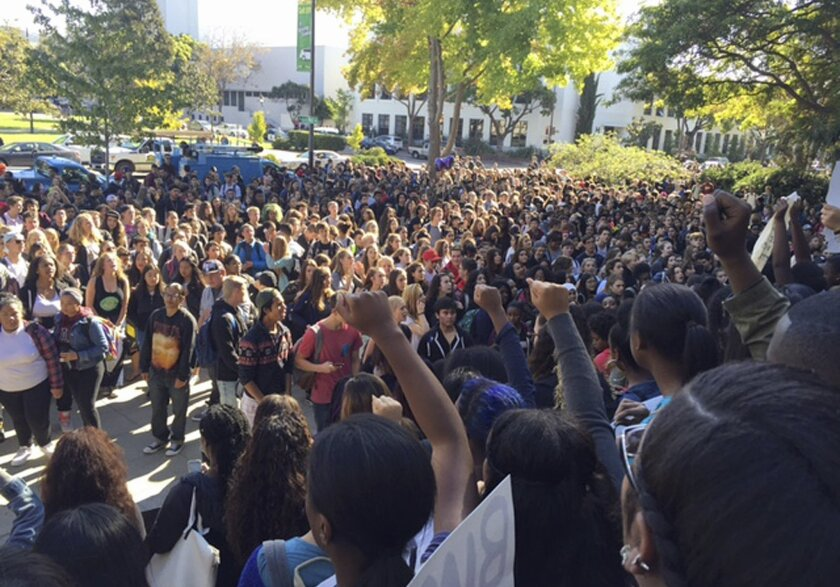 Berkeley High School students who walked out of class hold a protest in reaction to reports of racist slurs found the day before on a school library computer in Berkeley, Calif., Thursday, Nov. 5, 2015. The message referred to the KKK, using derogatory language related to African Americans and thre