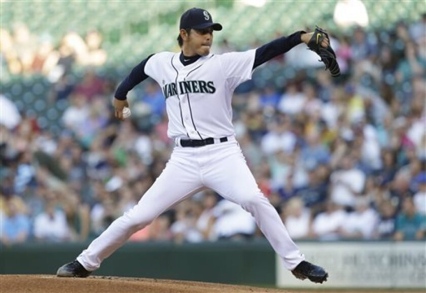 Seattle Mariners starting pitcher Hisashi Iwakuma throws in the first inning of a baseball game against the Boston Red Sox, Tuesday, July 9, 2013, in Seattle. (AP Photo/Ted S. Warren)