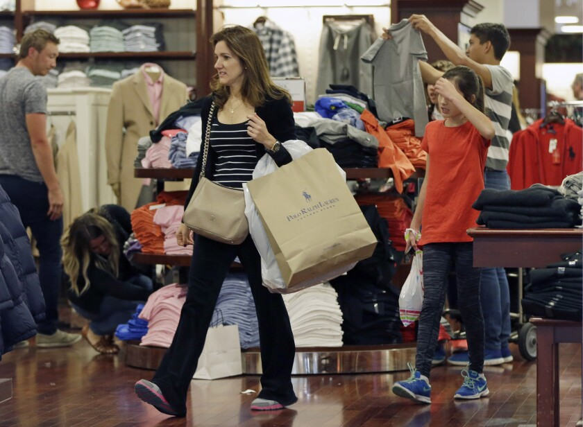 Shoppers at a Polo Ralph Lauren store in Miami on Nov. 25, 2016.