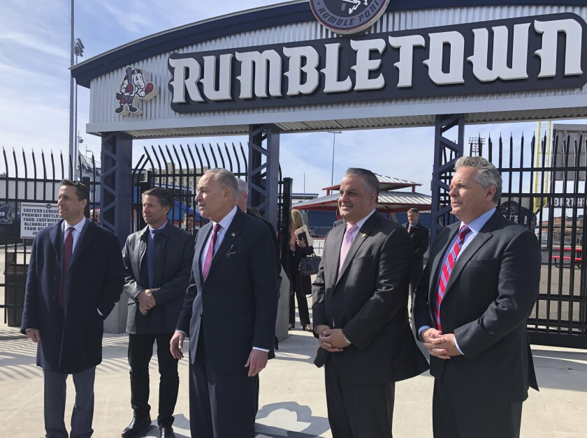 From left to right, MLB deputy commissioner Dan Halem, New York Mets chief operating officer Jeff Wilpon, U.S. Senate Minority Leader Chuck Schumer, Binghamton Mayor Rich David and Rumble Ponies owner John Hughes stand outside NYSEG Stadium in Binghamton, N.Y., Monday, Feb. 24, 2010. Sen. Schumer says Major League Baseball officials agreed to work to keep Binghamton's Double-A baseball team, which is among the 42 minor league franchises targeted to lose their big league affiliation. The New York Democrat met with Halem, Wilpon and Eastern League president Joe McEachern to discuss the future of the Rumble Ponies, a New York affiliate. (AP Photo/John Kekis)