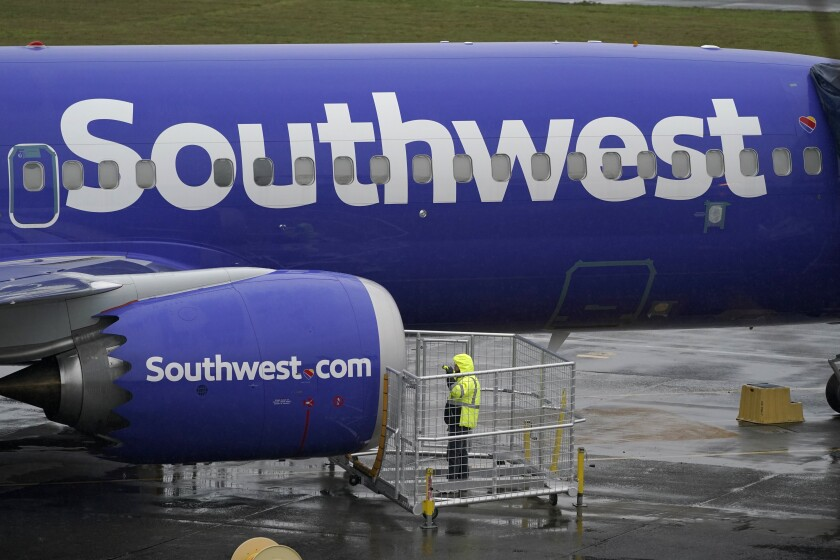 A worker inspects a Southwest airplane