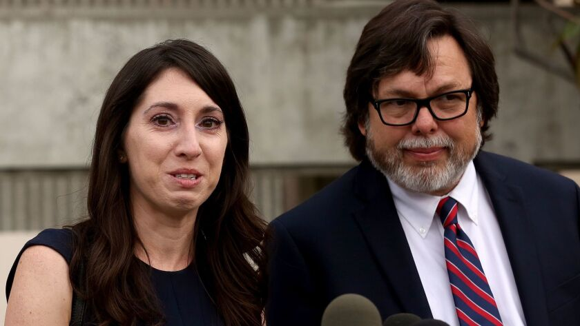 Michelle Hadley tears up while addressing reporters with her attorney Michael Guisti on Monday.