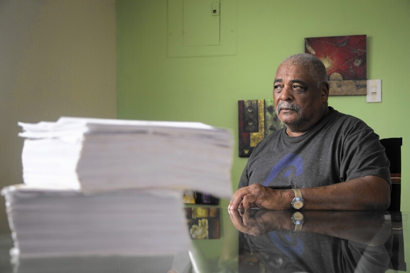 Ivan Figueroa Clausell with paperwork from his disability appeals to the Department of Veterans Affairs.
