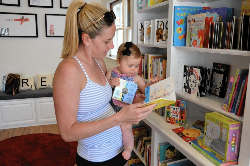 Kristen Horgan and daughter Charlotte browse through books at the newly opened Island Tales Book Shop.