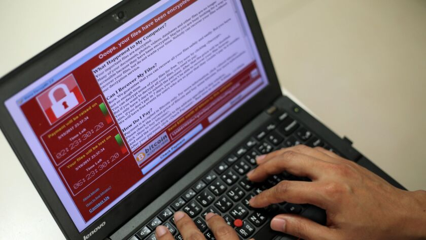 A programmer shows a sample of the ransomware cyberattack on a laptop in Taipei, Taiwan, on May 13, 2017.