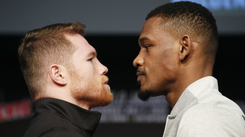 Canelo Alvarez, left, and Daniel Jacobs pose for photographers at a news conference for their middle
