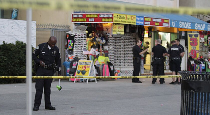 Venice Beach police investigate the scene where a person drove his car into a crowded Venice Beach boardwalk, injuring 12 people and fleeing the scene.