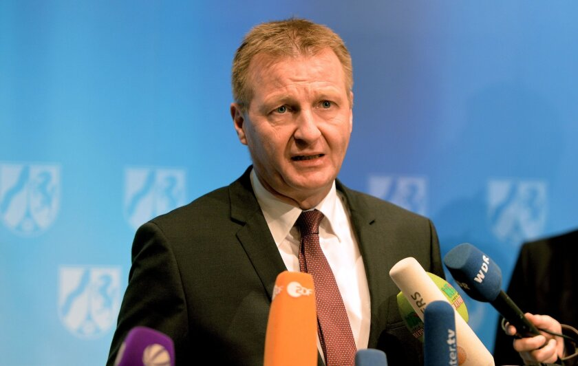 Ralf Jaeger, interior minister of Germany's North-Rhine-Westphalia, announces the firing of Cologne police chief Wolfgang Albers on Friday.