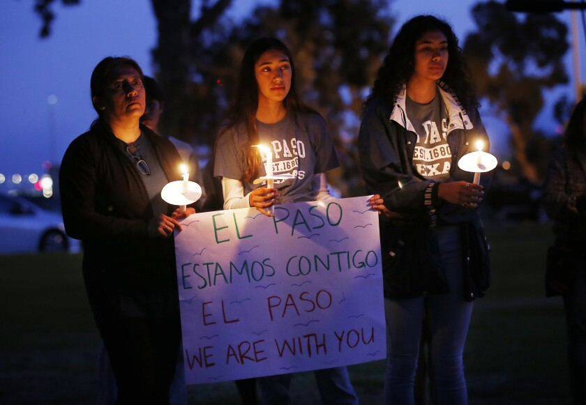 Gloria Serna, left, who was born and raised in El Paso, attends a candlelight vigil for the victims of the recent shootings with her daughters Maya, 15, center and Maritza, 17 at the Centro Cultural de la Raza in Balboa Park on August 11, 2019.