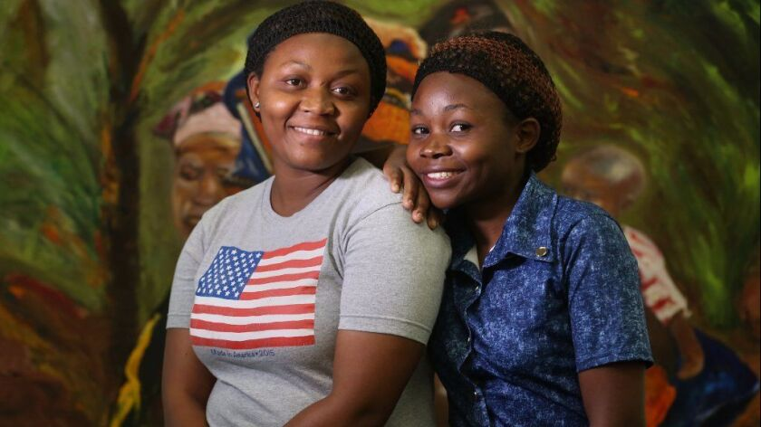Emily Sifa Ngandu, left, is a refugee from Congo who came to San Diego with her cousin Pendeza Batende.