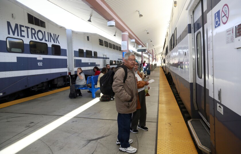 Passengers wait to board a Metrolink train at Union Station in downtown Los Angeles. A new safety measure is being expanded on the commuter system.