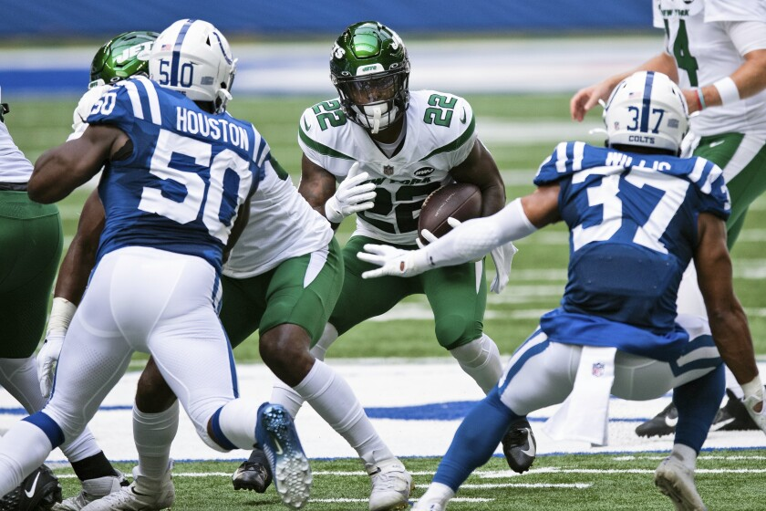 FILE - In this Sept. 27, 2020, file photo, New York Jets running back La'Mical Perine (22) looks for an opening in the line during an NFL football game between the Indianapolis Colts in Indianapolis. Perine was drafted in April to be the New York Jets' running back of the future. Well, that might already be now. And a bit sooner than many probably expected. (AP Photo/Zach Bolinger, File)