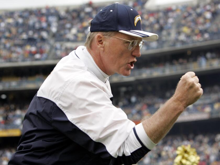Chargers coach Marty Schottenheimer cheers on players before a game on Sunday, Jan. 2, 2005 in San Diego.