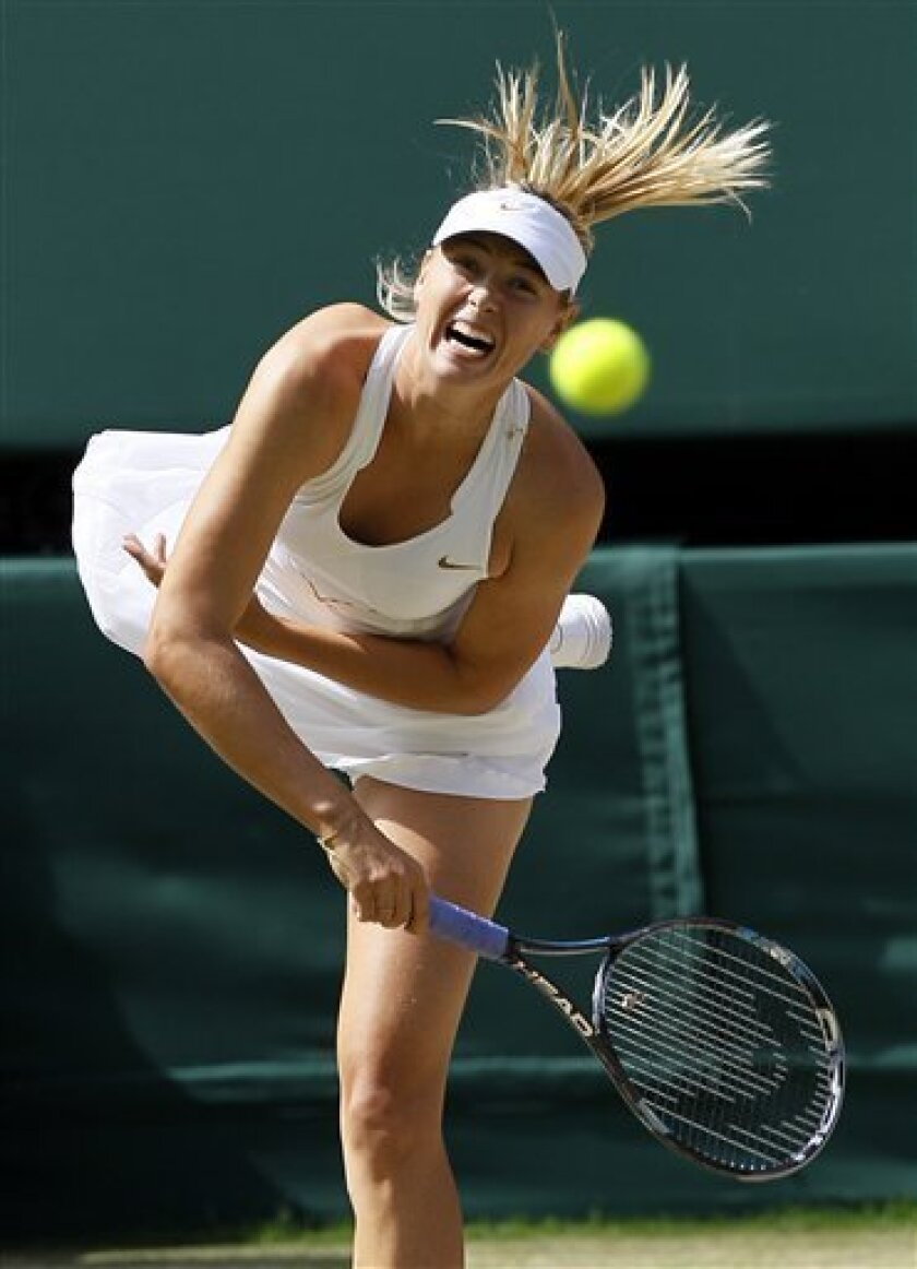 Russia's Maria Sharapova serves to Germany's Sabine Lisicki during their semifinal match at the All England Lawn Tennis Championships at Wimbledon, Thursday, June 30, 2011. (AP Photo/Kirsty Wigglesworth)