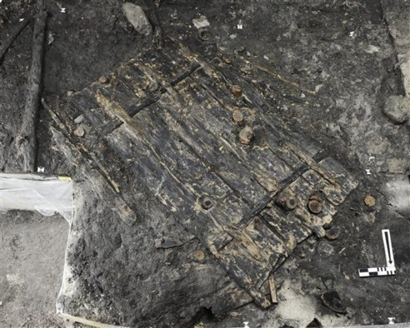"This undated photo provided by the Hochbaudepartment Zurich shows a 5,000-year old door that archaeologists in the Swiss city of Zurich have found and may be the oldest ever found in Europe. Chief archaeologist Niels Bleicher says the ancient poplar wood door is ""solid and elegant"" with well-preserved hinges and a ""remarkable"" design for holding the boards together. Bleicher said Tuesday, Oct. 19, 2010 the door has been dated to around 3,100-years B.C. (AP Photo/Hochbaudepartment Zurich, Handout)"