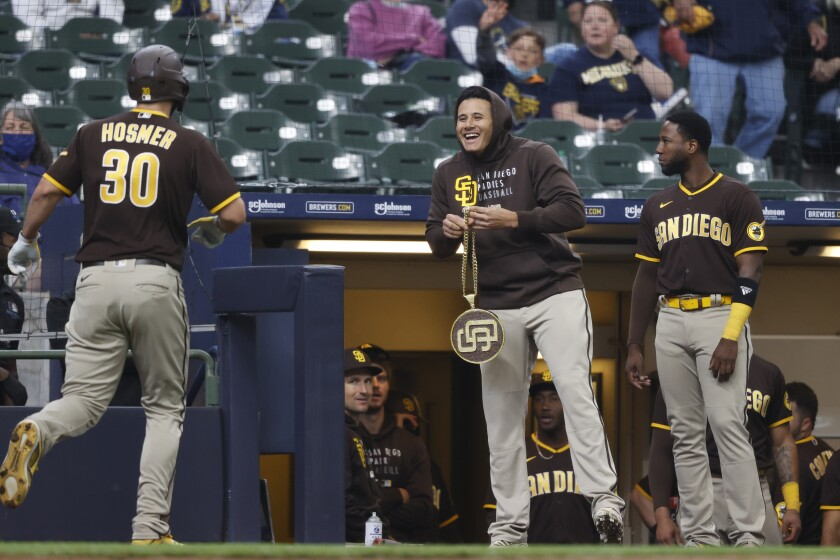"""Manny Machado gets ready to present the Padres' """"swag chain"""" to Eric Hosmer"""