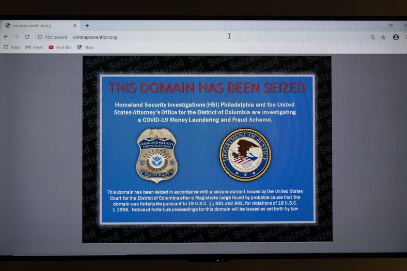 An illicit website selling unapproved treatments and preventions for the coronavirus is displayed at the National Intellectual Property Rights Coordination Center, Tuesday, Nov. 24, 2020, in Arlington, Va. (AP Photo/Alex Brandon)