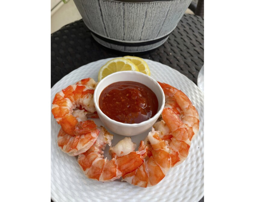 This photo taken May 19, 2021 in Alexandria, Va. shows grilled shrimp with bloody mary cocktail sauce. (Elizabeth Karmel via AP)