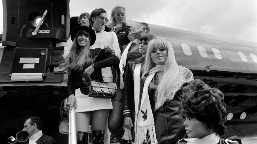 Playboy Magazine publisher Hugh Hefner, top center, his girlfriend actress Barbara Benton, left, and film director Roman Polanski, top left, arriving at Le Bourget airport in France in 1970.