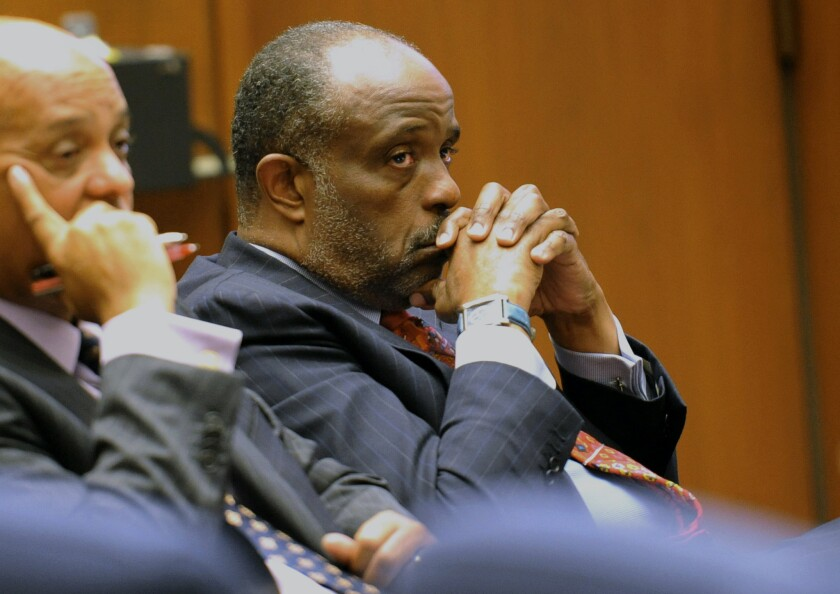 State Sen. Roderick Wright (D-Inglewood), right, listens during his perjury and voter fraud trial at Los Angeles Superior court. Roderick Wright has been convicted in a perjury and voter fraud case.
