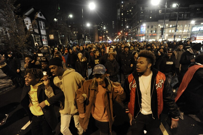 Protesters march during a protest for 17-year-old Laquan McDonald, who was fatally shot and killed in October 2014 in Chicago. Chicago Police Officer Jason Van Dyke was charged Nov. 24, 2015, with first-degree murder in the killing.