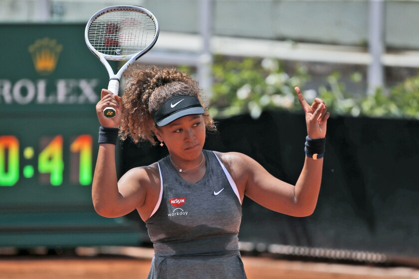 FILE - In this May 12, 2021 file photo, Naomi Osaka of Japan reacts after losing a point against Jessica Pegula of the United States during their match at the Italian Open tennis tournament, in Rome. Osaka's declaration that she won't participate in news conferences during the French Open is a natural topic for discussion on tournament media day in Paris. Other players say they understand Osaka's stance and respect her choice. (AP Photo/Alessandra Tarantino, File)