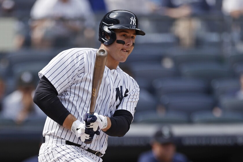 New York Yankees' Anthony Rizzo grounds into a run scoring double play during the sixth inning of a baseball game against the Seattle Mariners on Saturday, Aug. 7, 2021, in New York. (AP Photo/Adam Hunger)