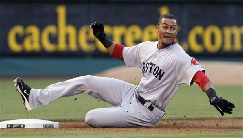 Boston Red Sox's Eric Patterson slides into third base with a triple off Oakland Athletics' Ben Sheets during the fourth inning of a baseball game Monday, July 19, 2010, in Oakland, Calif. (AP Photo/Ben Margot)