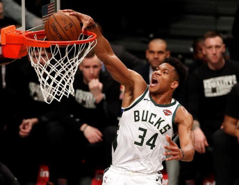 Milwaukee Bucks forward Giannis Antetokounmpo dunks the ball past the Brooklyn Nets defense in the first half of the game between the Milwaukee Bucks and the Brooklyn Nets at Barclays Center in Brooklyn, New York, USA, Feb. 04, 2019. EPA-EFE/JASON SZENES SHUTTERSTOCK OUT