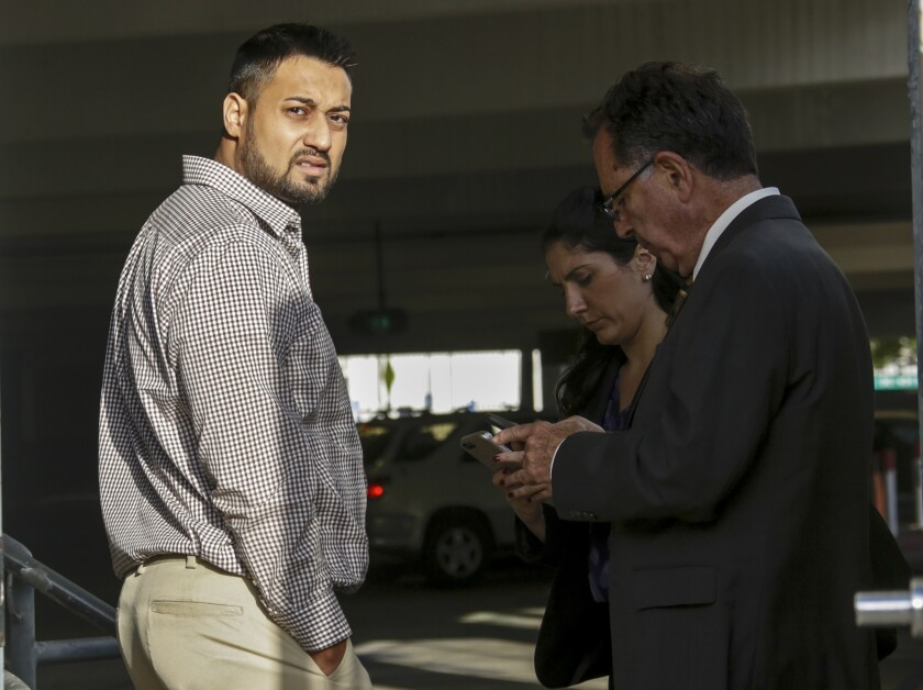 Syed Raheel Farook, left, is released on bail at the Riverside Federal Courthouse in April 2016. He and wife, Tatiana Farook, have pleaded guilty to charges of conspiracy to commit immigration fraud related to a sham marriage.