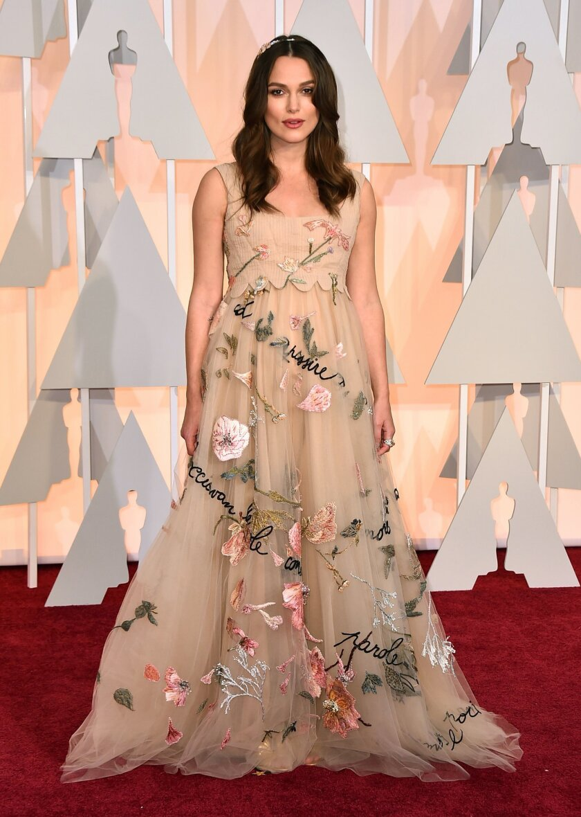 Keira Knightley arrives at the Oscars on Sunday, Feb. 22, 2015, at the Dolby Theatre in Los Angeles. (Photo by Jordan Strauss/Invision/AP)