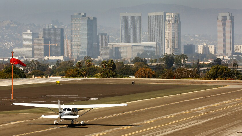 Aircraft land and liftoff at Santa Monica Airport in August.