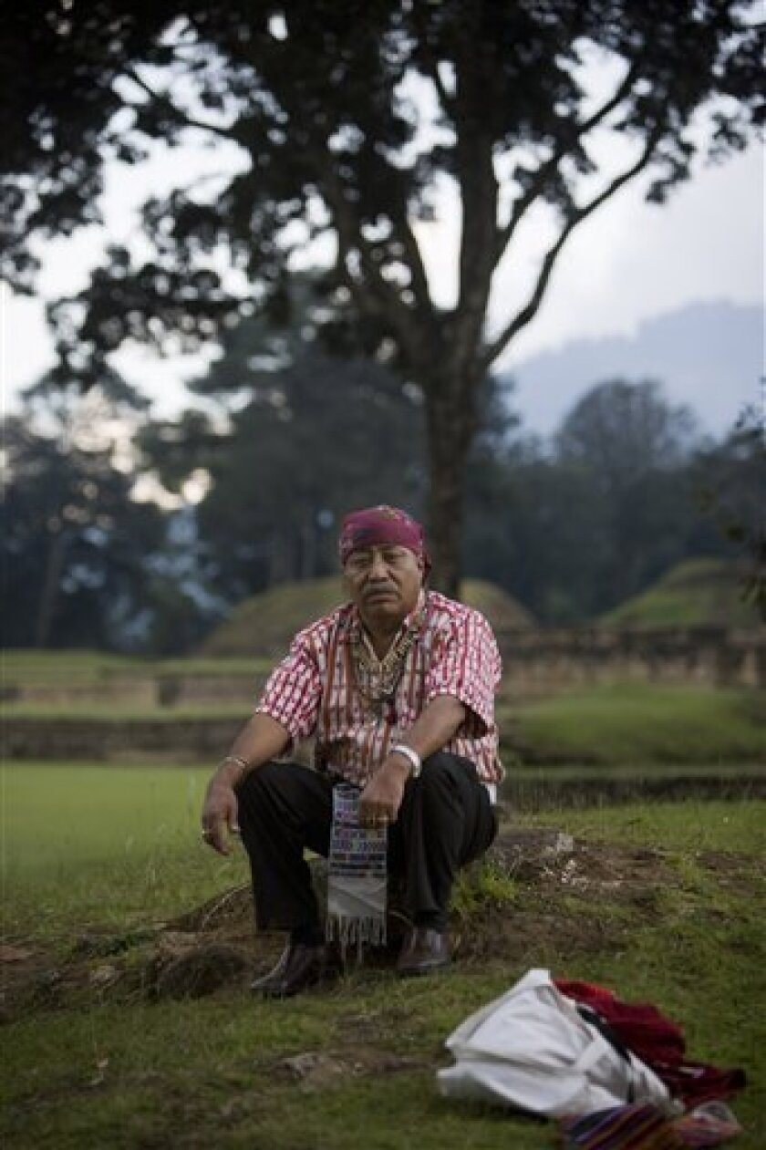 In this photo taken Oct. 3, 2009, Guatemalan Mayan Indian elder Apolinario Chile Pixtun poses for a portrait at the Iximche ceremonial site in Tecpan, Guatemala.  Archaeologists, astronomers and modern-day Mayas shrug off the popular frenzy over the date of 2012, predicting it will bring nothing mo