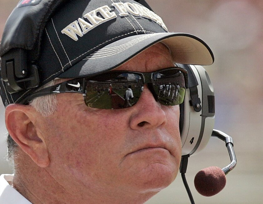 FILE - In this Sept. 15, 2012, file photo, Wake Forest head coach Jim Grobe watches from the sideline during the first quarter of an NCAA college football game against Florida State in Tallahassee, Fla. Those who have worked and played for the new Baylor coach, say he believes in tough love, a hand