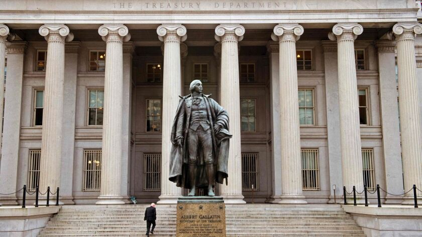 A statue of Alexander Hamilton stands outside the U.S. Treasury Department building in Washington, D.C.