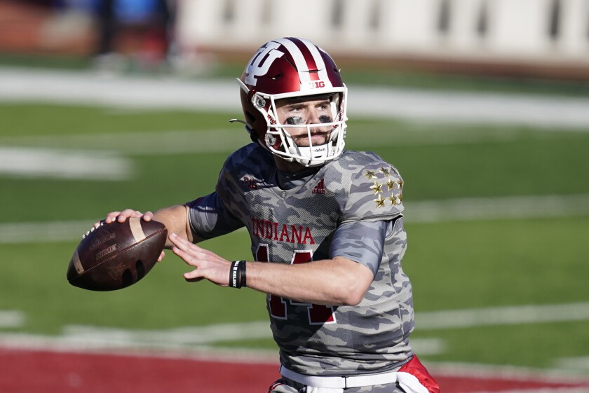 Indiana quarterback Jack Tuttle (14) throws during the second half of an NCAA college football game against Maryland, Saturday, Nov. 28, 2020, in Bloomington, Ind. Indiana won 27-11. (AP Photo/Darron Cummings)