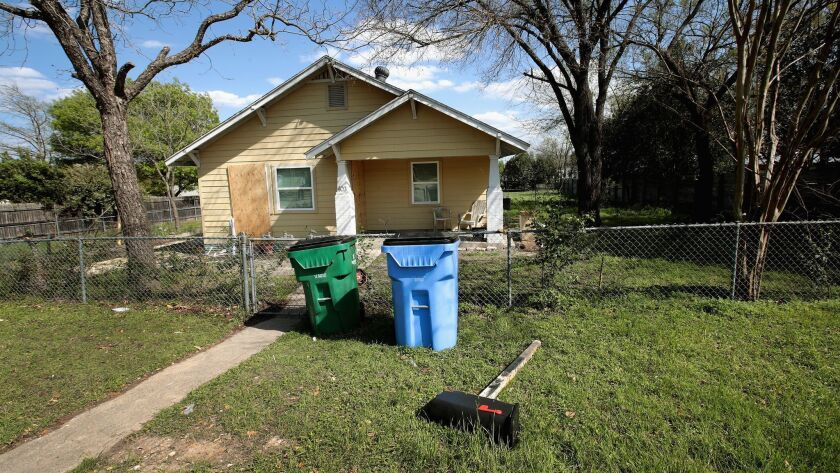 Plywood covers most of the windows at the home of Mark Anthony Conditt after the police investigated the property on Thursday in Pflugerville, Texas.