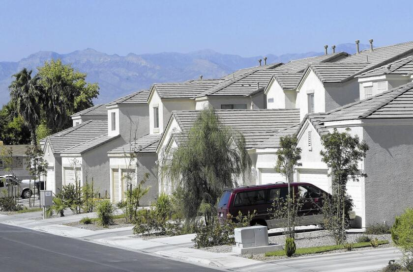 In Las Vegas, the traditional American front lawn has largely given way to desert-compatible landscaping, as seen here in 2004.